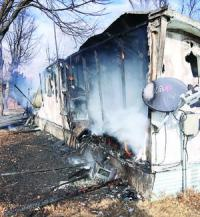 House, vehicle lost in Optima fire